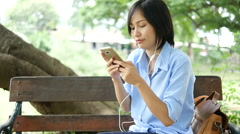 Asian woman using a smart phone, Arkistovideo