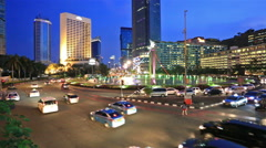 Traffic in Jakarta business district at night Stock Footage