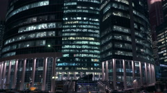 Business office view through the glass in buisness city at night.Timelapse, 4. Stock Footage