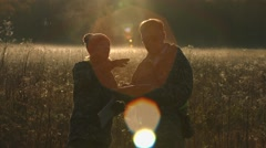 A man and a woman looking the way. Slow motion. Horizontal pan. Stock Footage
