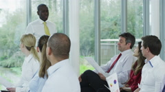 4K Business manager giving presentation to his team in training seminar Stock Footage