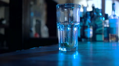 Timelapse: Bartender mixing alcohol and poured it into a cocktail glass in the Stock Footage