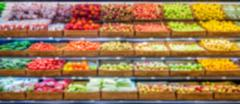 Blurred supermarket fruits and vegetables products Stock Photos