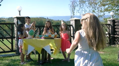 Five little kids sit at yellow table with cake at birthday party. Inscription Stock Footage