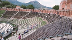Taormina in Sicily, italy tourists visiting ancient greek theater Stock Footage