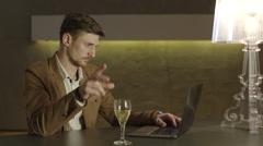 Businessman drinking wine Stock Footage