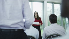 4K Business manager giving presentation to her team in training seminar Stock Footage