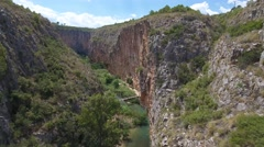 Sliding camera of Canyon and suspension bridges in Chulilla Stock Footage