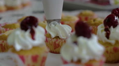 Bowl of raspberries with whipped cream and mint added Stock Footage