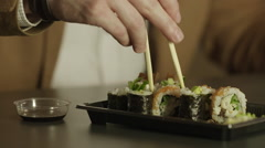 Eating sushi with chopsticks Stock Footage