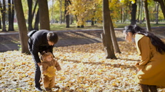 Parents play with the child in the woods Stock Footage