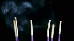 Burning incense sticks with smoke background Stock Footage
