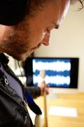 Male artist recording electric guitar in home studio Stock Photos