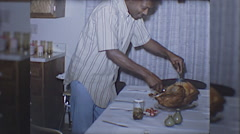 Black Man African American Thanksgiving Meal 1960s Vintage Film Home Movie 10061 Stock Footage