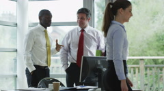 4K Business group in discussion in modern office with outdoor view Stock Footage