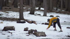 A man and woman having a snowball fight in the mountains, slow motion. Arkistovideo