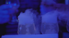 Barman holding ice cube cocktail glass. Bartender preparing alcoholic cocktails Stock Footage