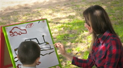 Little paintert shows mom how to draw pictures. Happy emotions. Close up Stock Footage