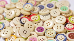 Mixed coloured bright wooden buttons Stock Footage
