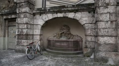 Decorative European Fountain and a bike in Germany Stock Footage