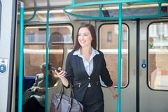 Businesswoman travelling in Docklands Light Railway train, London Stock Photos