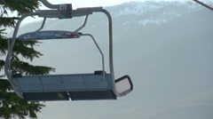 Chairlift at a ski resort, super slow motion. Stock Footage