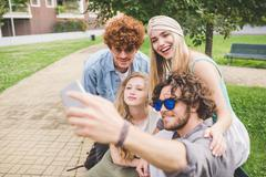 Friends taking selfie in park Stock Photos