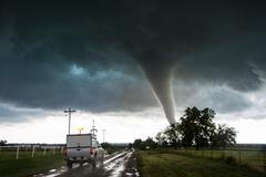 Storm vehicle with the Center for Severe Weather Research driving into the path Stock Photos