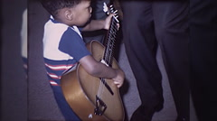 African American Little Black Boy Plays Guitar 60s Vintage Film Home Movie  Stock Footage