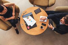 Young businessman and woman meeting in office lobby Stock Photos