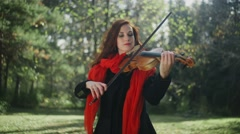 A musician with a bright appearance. Playing the violin Stock Footage