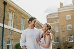 Happy young couple strolling along Kings Road, London, UK Stock Photos