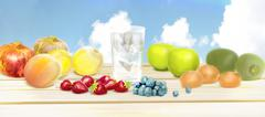 Fresh fruits and pure water on a wooden table. Healthy eating, dieting, love Stock Illustration