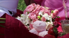 Bouquet of roses on a picnic Stock Footage