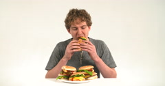 Fast food competition slow motion hamburger eating sause falling vat grosse 4 Stock Footage