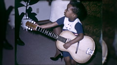 African American Black Boy Plays Guitar 1960s Vintage Film Home Movie 10045 Stock Footage