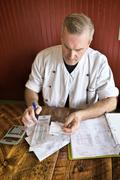 Chef working on accounts Stock Photos