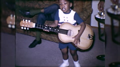 African American Black Boy Plays Guitar 1960s Vintage Film Home Movie 10044 Stock Footage