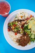 Chicken, salad, rice and peas dish Stock Photos