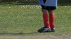 Young boy kicking soccer ball during a youth soccer league game. Stock Footage