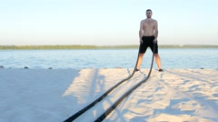 Battle ropes on the river bank Stock Footage