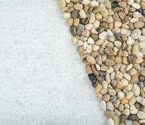 Small stones on stone background, concept of harmony and tranquility Stock Photos