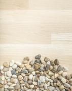 Stones on wooden background, concept of harmony and tranquility Stock Photos