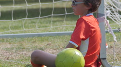 Young boy soccer player posing by the goal. Stock Footage