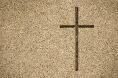 Detail of cross on tombstone in cemetery Stock Photos