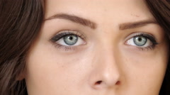 Extreme Close up of ayoung woman's face with striking blue eyes Stock Footage