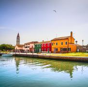 Venice landmark, Burano island canal, colorful houses, church and boats, Ital Stock Photos