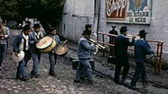 Ecuador 1970: musicians walk into a bullfighting arena Stock Footage