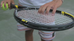 Close-up of young man holding tennis racquet in hand. Stock Footage