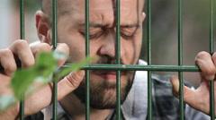 Sad divorced father observes in secret son Stock Footage